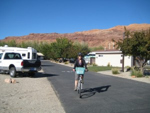 Connie biking into Portal RV Park, Moab