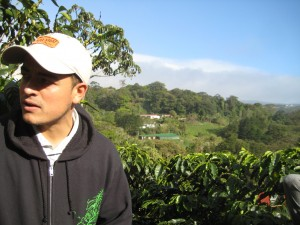 Jorge with coffee plantation behind him