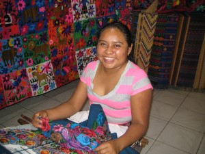 Vivien at her loom on the floor of her shop