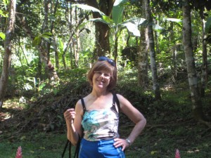 Connie down in the rainforest in front of cabina