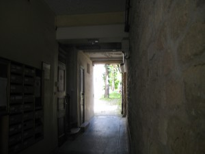 Behind entry door a passageway to courtyard