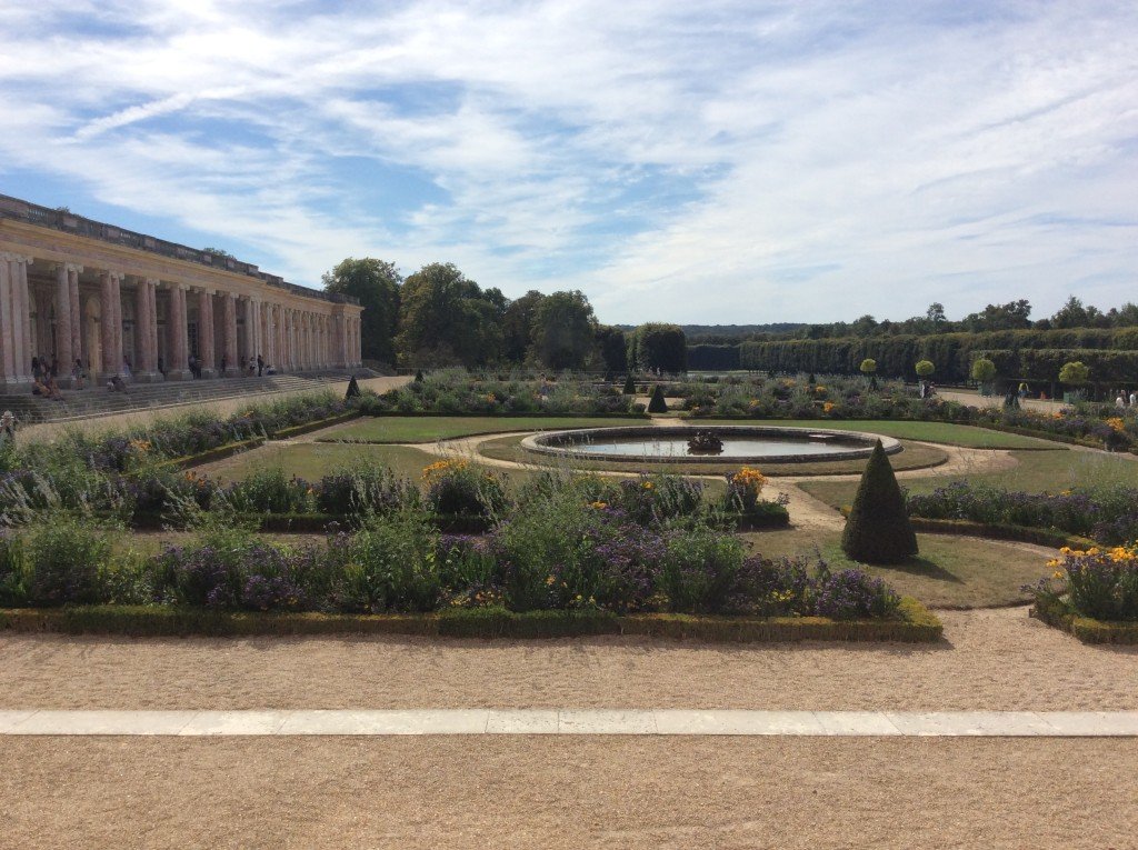 A view of the gardens from a wing of The Grand Trianon facing the walkway