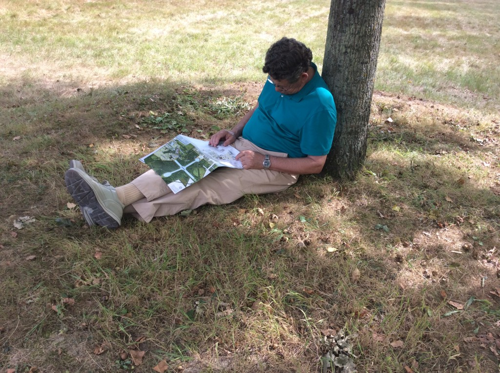 Bill trying to read map but a sleep overtakes him after a long day of signtseeing
