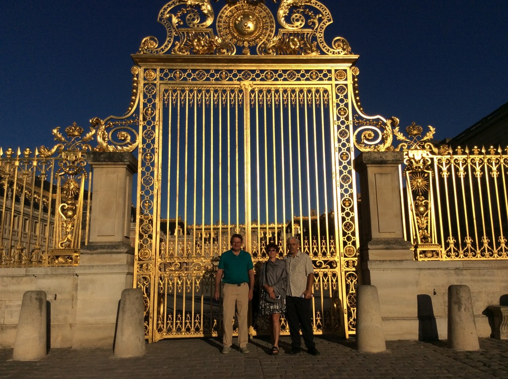 Kirk, Marcy and Bill at the entry gates to the chateau of Versailles